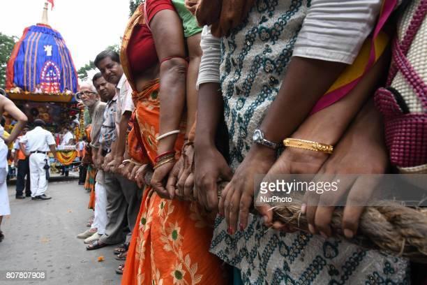 Indian Hindu Devotees join at the ISKCON 46th Ultta Rath Yatra on July 032017 in Kolkata IndiaThe three deities of Jagannath Balabhadra and Subhadra...