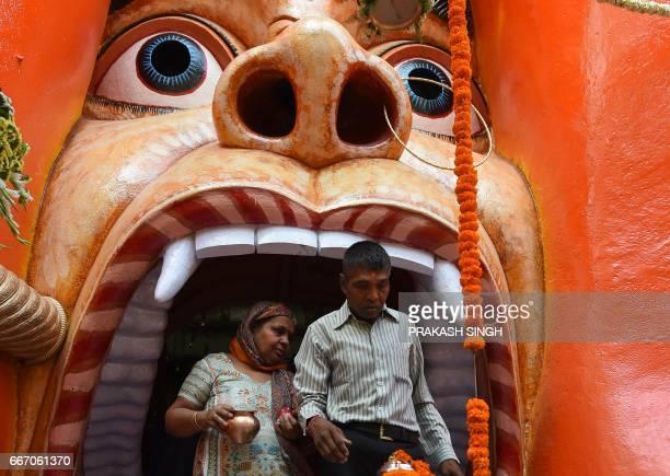 Indian Hindu devotees leave a temple of Lord Hanuman the monkey god of Hindu mythology to mark Hanuman Jayanti Hanuman's birth in New Delhi on April...