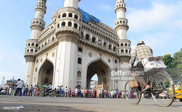 Indian Hindu devotees line up around the Charminar monument to offer prayers at Bhagyalakshmi Temple in Hyderabad on October 11 2013 The Shri...