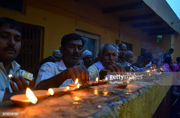 Indian hindu devotees lit earthen lamps outside of Ram Templeduring a Religious processsion on ocassion of Diwali festivalat Chitrakootabout 128 kms...