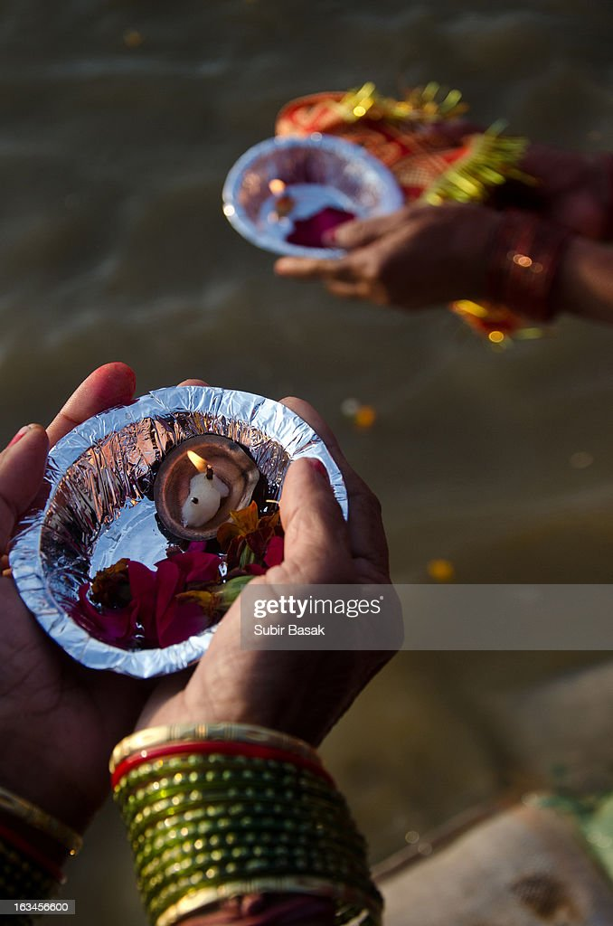 CONTENT] Indian Hindu devotees makes flower with oil lamps offering near the Sangam or confluence of the Yamuna, Ganges and mythical Saraswati rivers at the Kumbh Mela in Allahabad on February 9, 2013. The Kumbh Mela in the town of Allahabad will see up to 100 million worshippers gather over 55 days to take a ritual bath in the holy waters, believed to cleanse sins and bestow blessings.