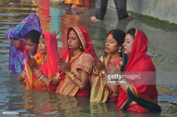 Indian Hindu devotees offer prayers to Sun God while standing in the water on the occasion of Chhat Puja festival in Agartala capital of the north...
