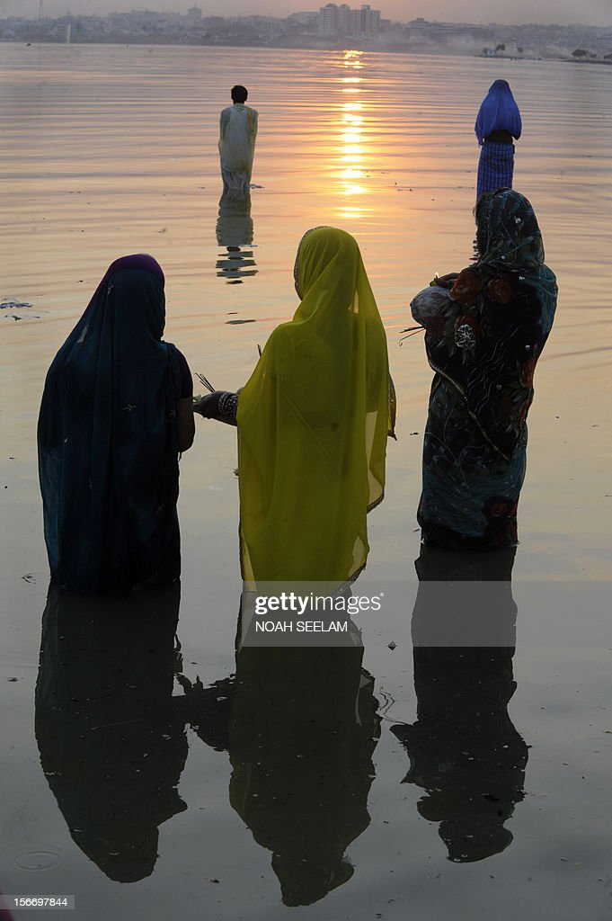 Indian Hindu devotees offer prayers to the sun during the Chhath Festival on the banks of the Hussain Sagar lake in Hyderabad on November 19, 2012.T he Chhath festival is observed in the eastern part of India, where homage is paid to the sun and water Gods eights days after Diwali, the festival of lights. AFP PHOTO / Noah SEELAM