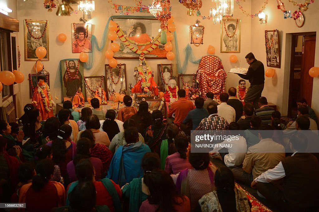 Indian Hindu devotees offers prayers as they celebrate the birth anniversary of Sri Sathya Sai Baba at a temple in Amritsar on November 23, 2012. Sri Sathya Sai Baba was an Indian guru, spiritual figure, mystic, philanthropist and educator who died in April 2011.