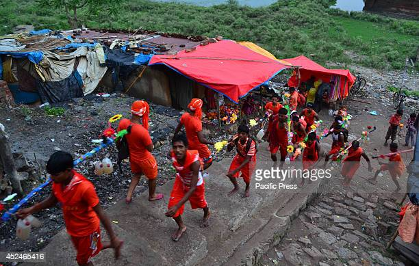 Indian Hindu devotees or 'Kanwariyas' move for their Kanwar yatra in Allahabad The Yatra takes place during the sacred month of Shravan from July to...