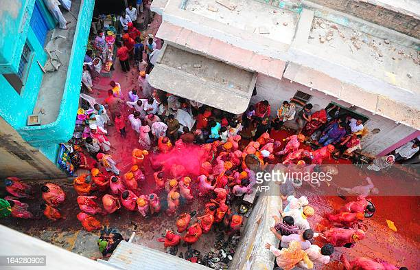 Indian Hindu devotees participate in rituals for the Lathmar Holi festival at the Nandji Temple in Nandgaon on March 22 2013 Lathmar Holi is a local...