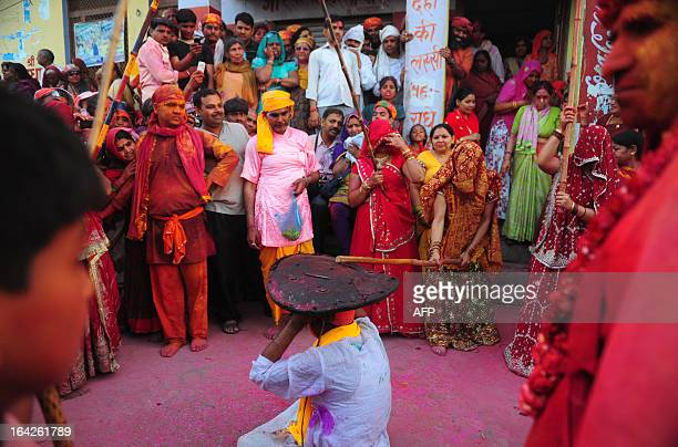 Indian Hindu devotees participate in rituals for the Lathmar Holi festival in Barsana on March 21 2013 Lathmar Holi is a local celebration but it...
