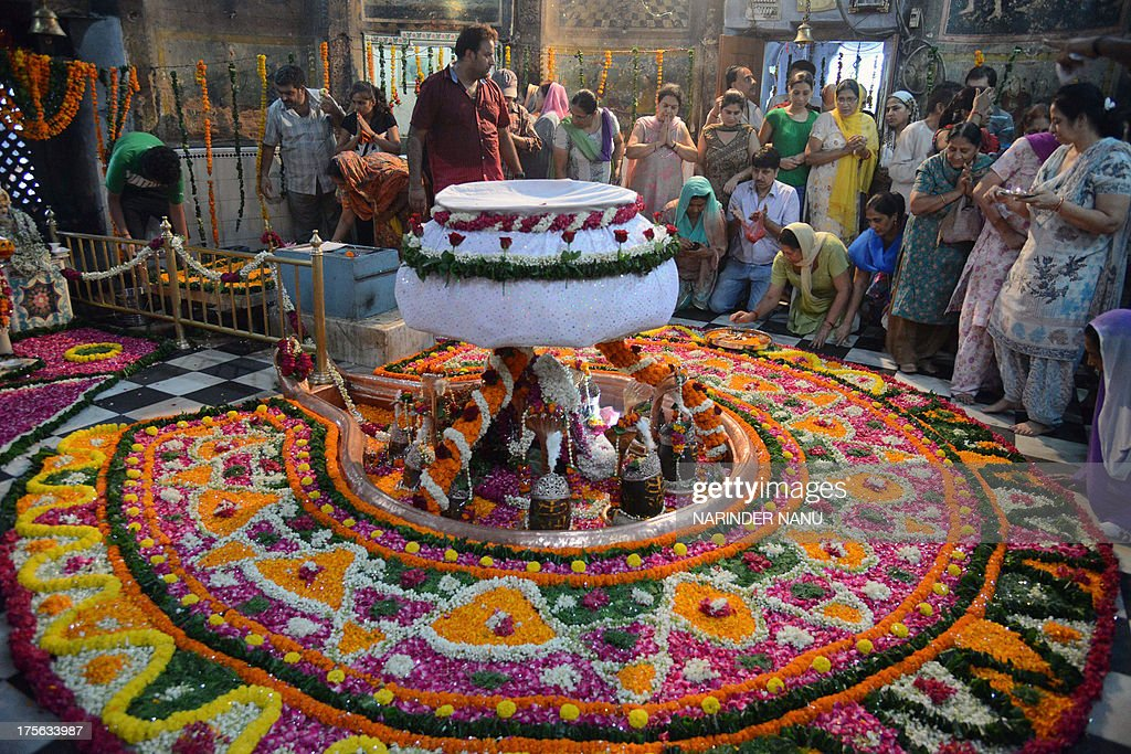 Indian Hindu devotees pay their respects to the eleven Shivlinga of Lord Shiva at the historical Shivala Veer Ban for Sawan Somvar in Amritsar on August 5, 2013. Sawan is the fifth month of the Hindu calendar and is considered the holiest month of the year. Sawan Somvar or Shravan Somvar (July - August) is an observance dedicated to Lord Shiva.