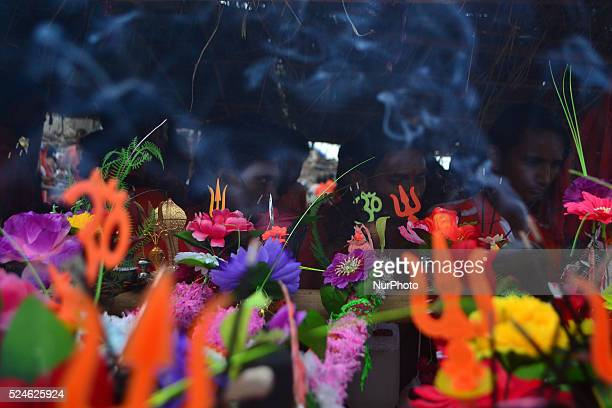 Indian hindu devotees prepare for Kanwar yatra as they worship before startting this sacred Yatra on the sacred month of Shravan at Daraganj Ghat in...