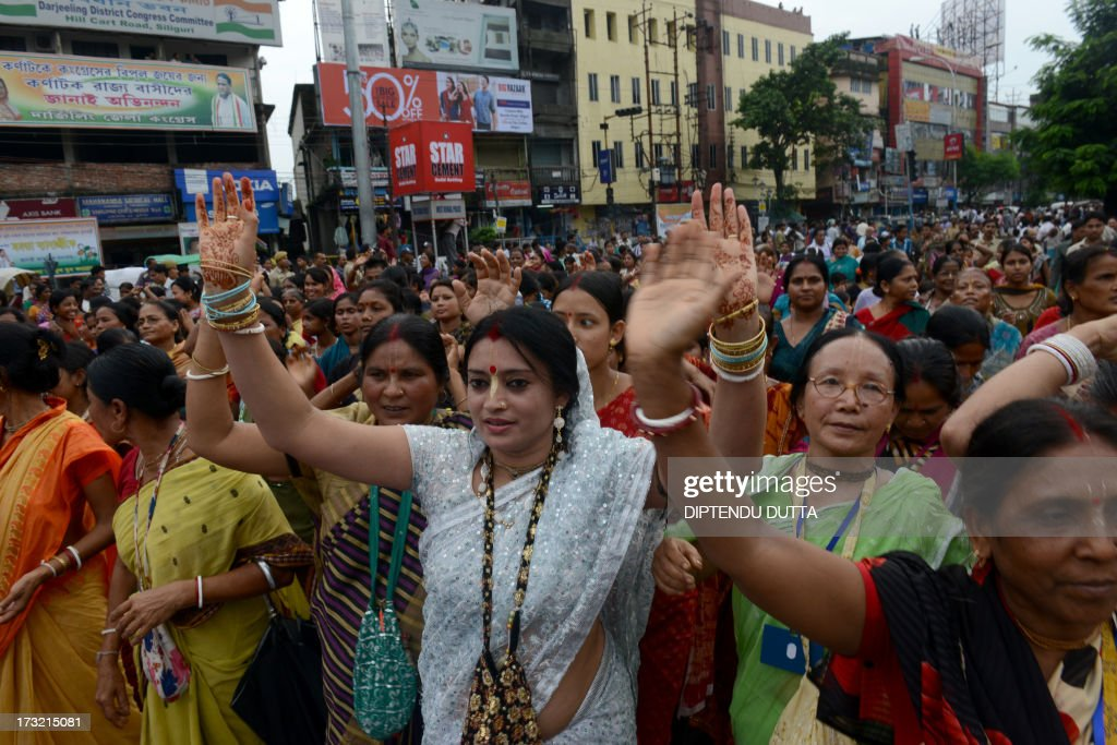 Indian Hindu devotees pull Lord Jagannath's chariot during Rath Yatra celebrations in Siliguri on July 10, 2013. This year marks the 136th annual Rath Yatra, where wooden images or idols of Lord Jagannath, his brother Balabhadra and sister Subhadra are mounted on ceremonial chariots and taken out in a procession with the participation of thousands of devotees. AFP PHOTO/Diptendu DUTTA