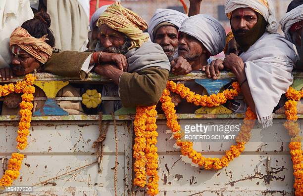 Indian Hindu devotees ride in the back of a truck during the Kumbh Mela in Allahabad on January 14 2013 Hundreds of thousands of Hindu pilgrims led...