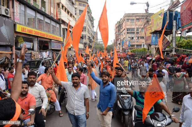 Indian Hindu devotees shouts slogans during the rally on the eve of Ram Navami festival in Kolkata India on Wednesday 5th April 2017