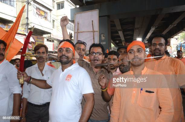 Indian Hindu devotees shouts slogans with sword during the rally on the eve of Ram Navami festival in Kolkata India on Wednesday 5th April 2017