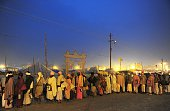 Indian Hindu devotees stand in a queue outside a free meal distribution camp at the Sangam the confluence of the Ganges Yamuna and mythical Saraswati...