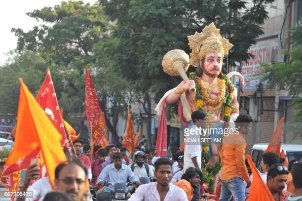 Indian Hindu devotees take part in a procession to mark Hanuman Jayanti the birthday of the Hindu monkeygod Lord Hanuman in Hyderabad on April 11...