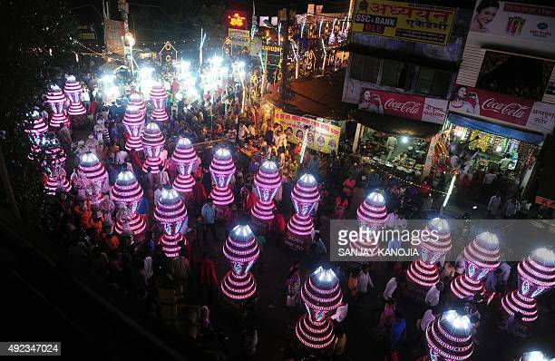 Indian Hindu devotees take part in a religious procession known as 'Karan Ghoda' during a celebration to mark the Dussehra Festival in the old city...