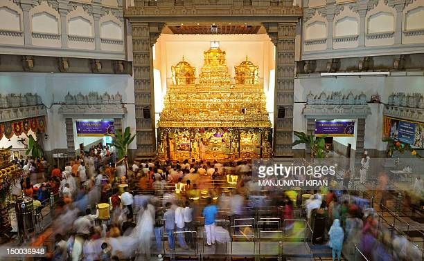 Indian Hindu devotees visit the International Society for Krishna Consciousness temple in Bangalore on August 9 2012 on the eve of 'Krishna...