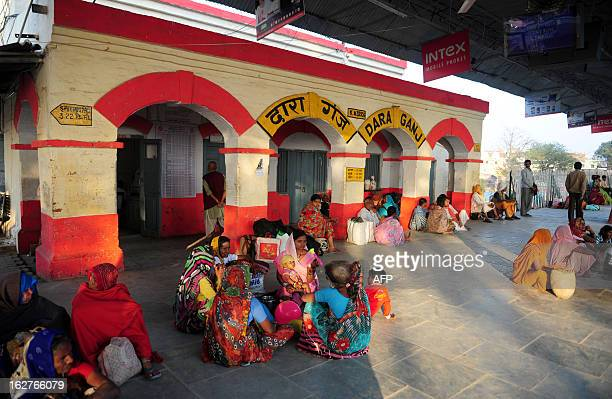 Indian Hindu devotees wait for their train at the Daraganj railway station in Allahabad on February 26 2013 The railway the country's largest...