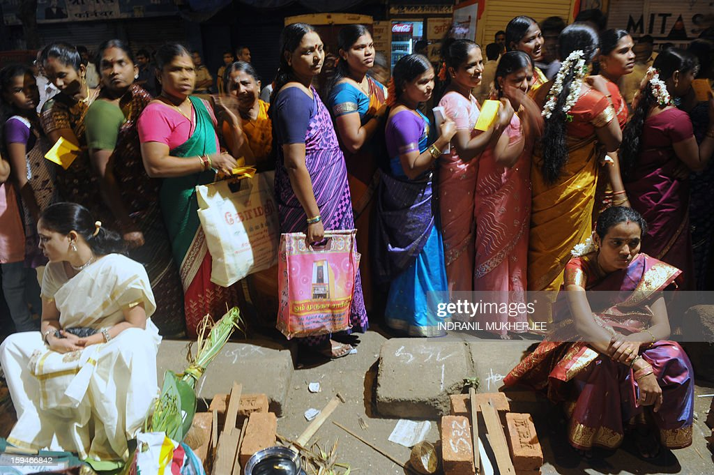 Indian Hindu devotees wait in queue to attend a community function on the occasion of Pongal in Mumbai on January 14, 2013. Pongal is a thanksgiving or harvest festival celebrated by people hailing from the Indian state of Tamil Nadu. Pongal-which coincides with the Hindu festival Makara Sankranthi and is celebrated throughout India as the winter harvest, is usually held from January 13–16.