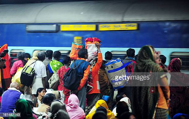 Indian Hindu devotees wait to board a train at the site of a stampede the night before at the main station in Allahabad on February 11 2013 Survivors...