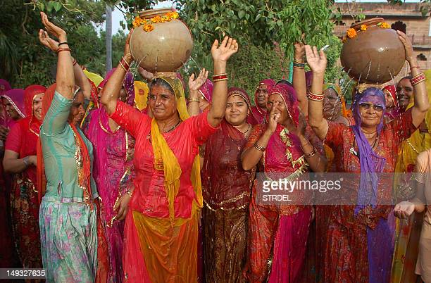 Indian Hindu devotes women dance during a special mass prayer for rain at Mandor Garden in Jodhpur on July 27 2012 The monsoon rains a key to India's...