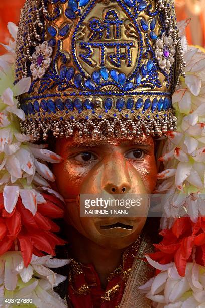 Indian Hindu dressed as monkey god Hanuman participates in a religious procession at the grounds in Amritsar on October 22 on the occasion of the...
