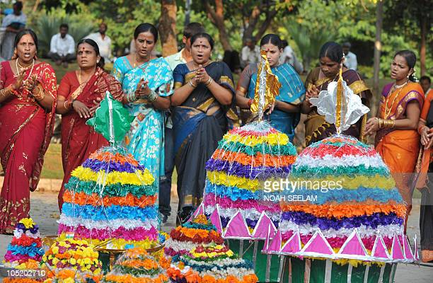 Indian Hindu female members of the Bharatiya Janata Party perform rituals with floral displays as they celebrate the 'Bathukamma' or 'Life Giver'...