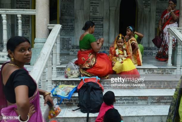 Indian Hindu girls arrive to take part in the Kumari Puja at the Adyapeath Ashram on the outskirts of Kolkata on April 5 2017 Kumari Puja a tradition...