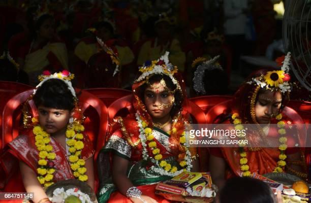 Indian Hindu girls look on during the Kumari Puja at the Adyapeath Ashram on the outskirts of Kolkata on April 5 2017 Kumari Puja a tradition of...