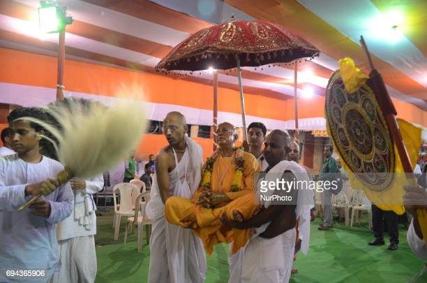 Indian Hindu priests carrying statue Swami Prabhupad the founder of ISKCON International Society for Krishna Consciousness during the holy Snan Yatra...