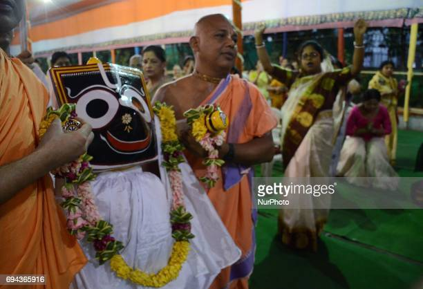 Indian Hindu priests carrying the idol God Jagannath before the of holy Snan Yatra or bathing ceremony ahead of their Ratha Yatra or chariot festival...