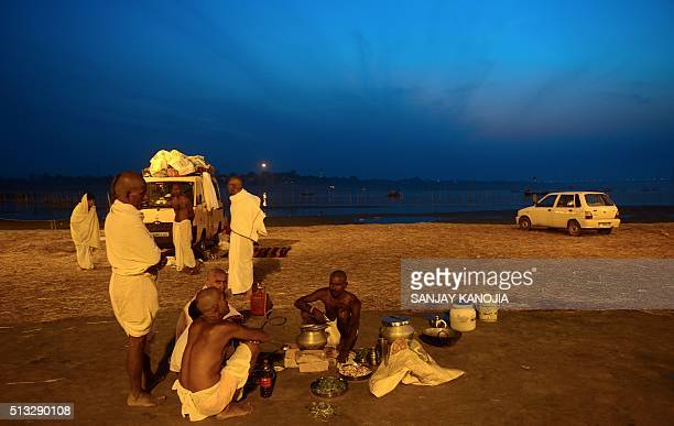 TOPSHOT Indian Hindu priests gather to prepare food after performing a ritual at the Sangam the confluence of the rivers Ganges Yamuna and mythical...