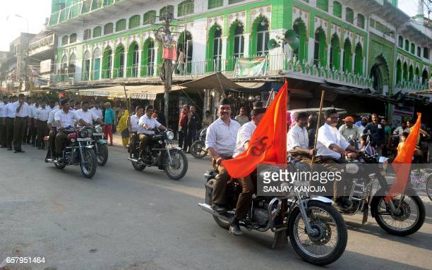 Indian Hindu Rashtriya Swayamsevak Sangh volunteers led by motorcyclists march during an event in Allahabad on March 26 held to mark the forthcoming...