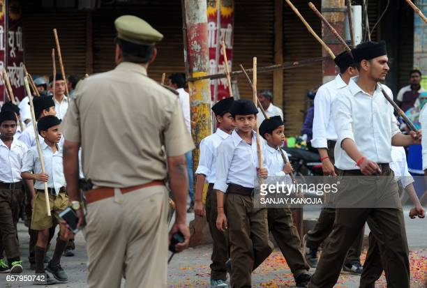 Indian Hindu Rashtriya Swayamsevak Sangh volunteers march during an event in Allahabad on March 26 held to mark the forthcoming Hindu New Year / AFP...