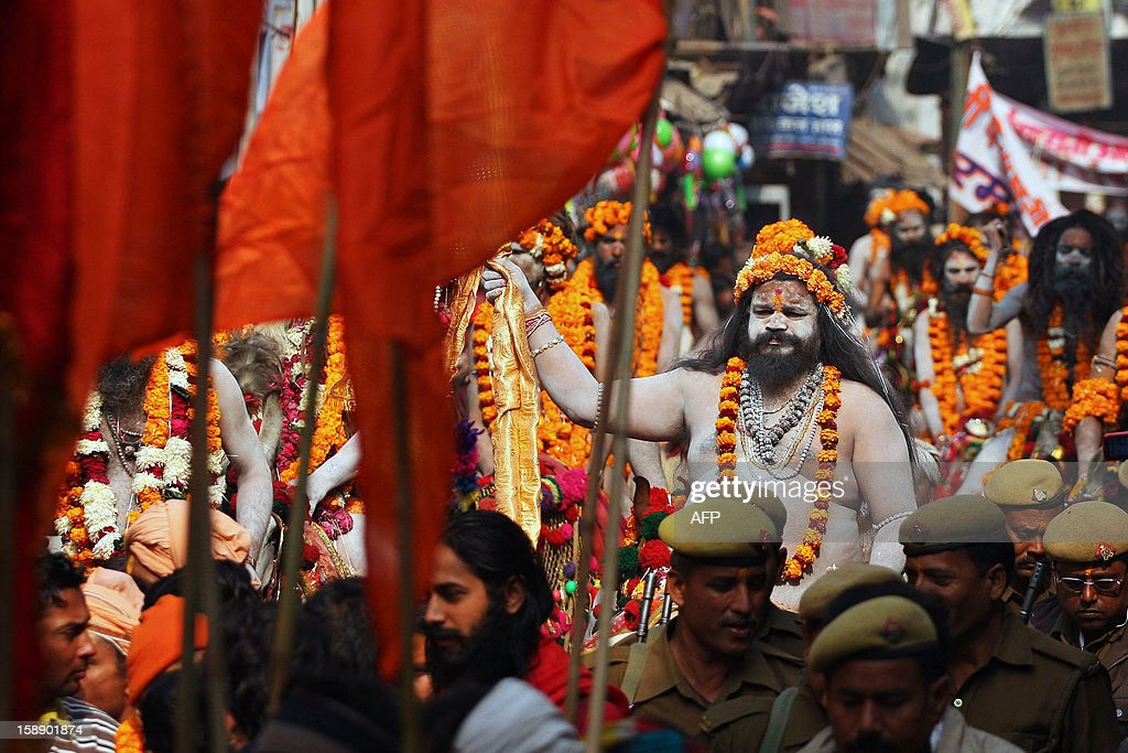 Indian Hindu Saddhus (hole men) participate in a religion procession as the first 'royal entry' for the Kumbh Mela at Sangam in Allahabad on January 3, 2013. The Kumbh Mela, which is scheduled to take place in the northern Indian city in January and February 2013, is the world's largest gathering of people for a religious purpose and millions of people gather for this auspicious occasion. AFP PHOTO/ Sanjay KANOJIA