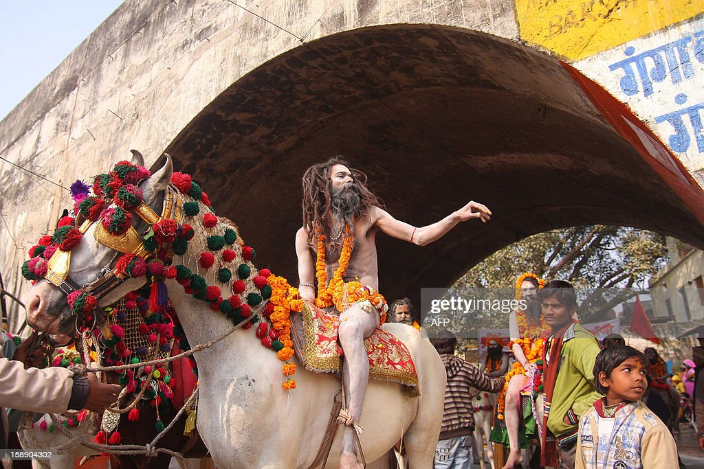 Indian Hindu Saddhus (holy men) participate in a religion procession as the first 'royal entry' for the Kumbh Mela at Sangam in Allahabad on January 3, 2013. The Kumbh Mela, which is scheduled to take place in the northern Indian city in January and February 2013, is the world's largest gathering of people for a religious purpose and millions of people gather for this auspicious occasion. AFP PHOTO/ Sanjay KANOJIA