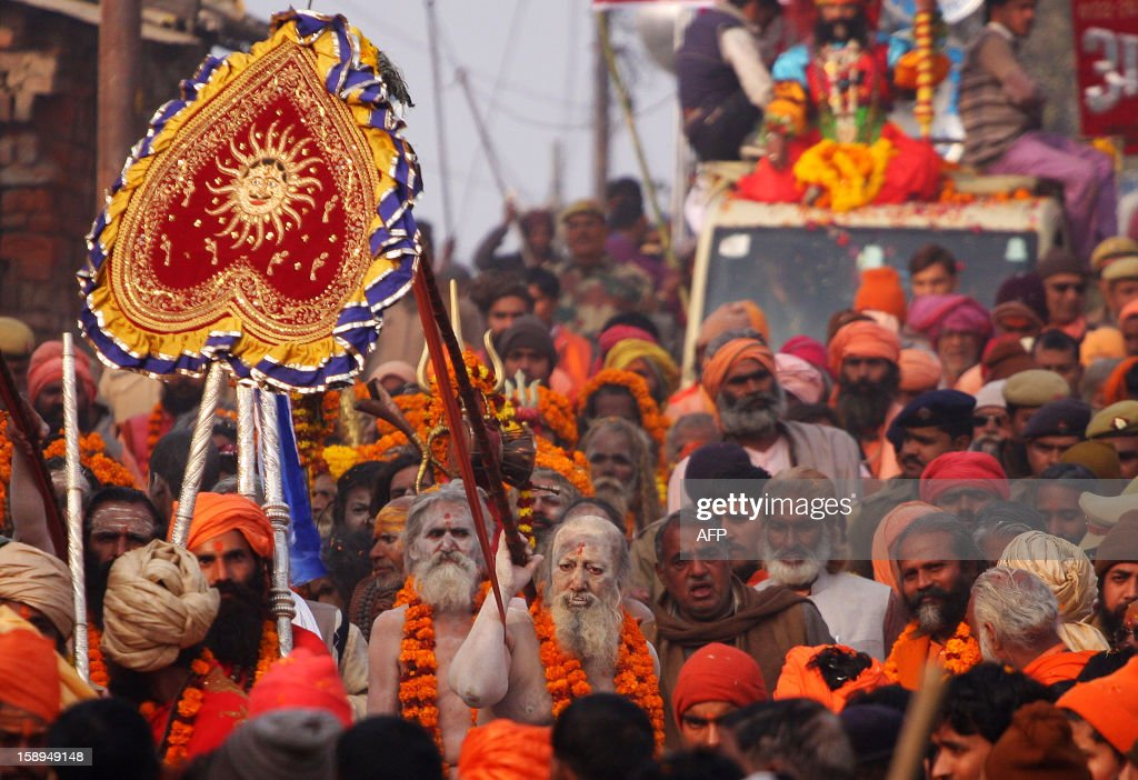 Indian Hindu Saddhus (holy men) participate in a religion procession in preparation for the Kumbh Mela at Sangam in Allahabad on January 4, 2013. The Kumbh Mela, which is scheduled to take place in the northern Indian city in January and February 2013, is the world's largest gathering of people for a religious purpose and millions of people gather for this auspicious occasion. AFP PHOTO/ Sanjay KANOJIA