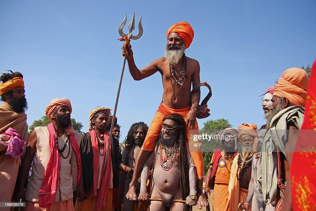 Indian Hindu Saddhus (holy men) take part in a religious procession toward Sangam in Allahabad on December 18, 2012. The Kumbh Mela, which is scheduled to take place in the northern Indian city in January and February 2013, is theworld's largest gathering of people for a religious purpose and millions of people gather for this auspicious occasion. AFP PHOTO/Sanjay KANOJIA