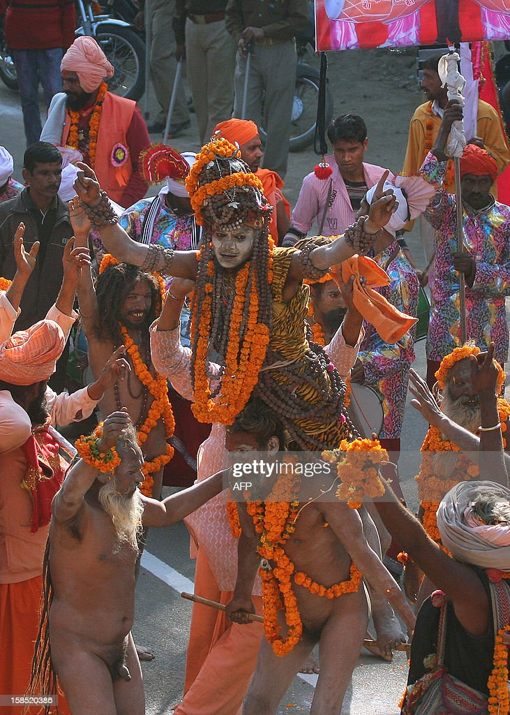 Indian Hindu Sadhus (holy men) from the Juna Akhara take part in a religious procession towards Sangam in Allahabad on December 18, 2012, the first 'Royal Entry' to the Kumbh Mela. The Kumbh Mela, which is scheduled to take place in the northern Indian city in January and February 2013, is theworld's largest gathering of people for a religious purpose and millions of people gather for this auspicious occasion. AFP PHOTO/Sanjay KANOJIA