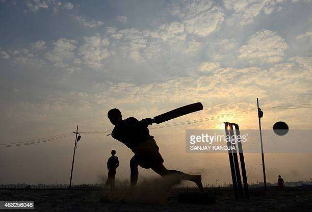 Indian Hindu Veda Vidyalaya students play cricket on the bank of the river Ganga near Sangam in Allahabad on February 12 2015 The ICC Cricket World...