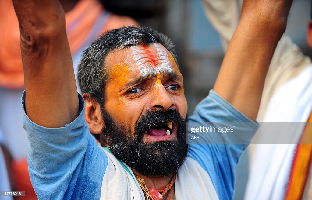 Indian Hindu VHP members shout slogans before attempting a procession in Ayodhya on August 25, 2013. Indian police arrested leaders of a Hindu forum to try and prevent a march to a pilgrimage town where the 1992 razing of a mosque sparked deadly sectarian riots. Organisers from the Vishwa Hindu Parishad (VHP, World Hindu Council) and the Press Trust of India (PTI) said some 125 people were detained in the northern state of Uttar Pdaesh.