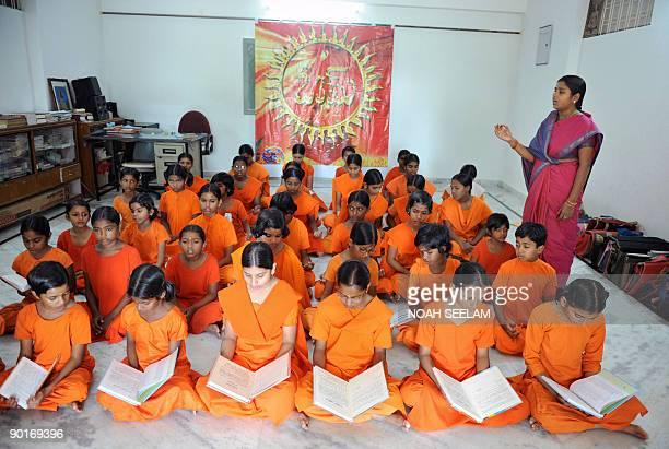 Indian Hindu woman priest Acharya Savitha teaches religious class to young girls aspiring to become priests at the Pani Prabhata Kanya Maha...