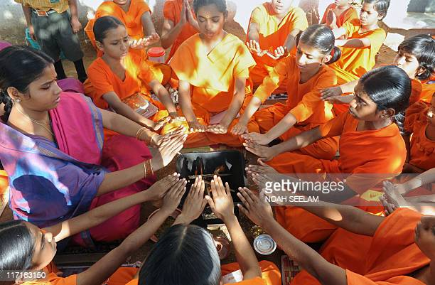Indian Hindu woman priest Acharya Savitha teaches religious rituals to young girls aspiring to become priests at the Pani Prabhata Kanya Maha...