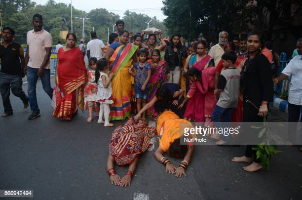 Indian Hindu women devotees performing the rituals of Chhath Puja on the banks of river Ganges in Kolkata India on Thursday 26th October 2017 The...