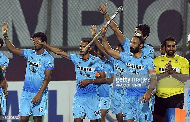 Indian hockey captain Sardar Singh acknowledges the spectators alongwith teammates after victory over Belgium during their Hero Hockey Champions...