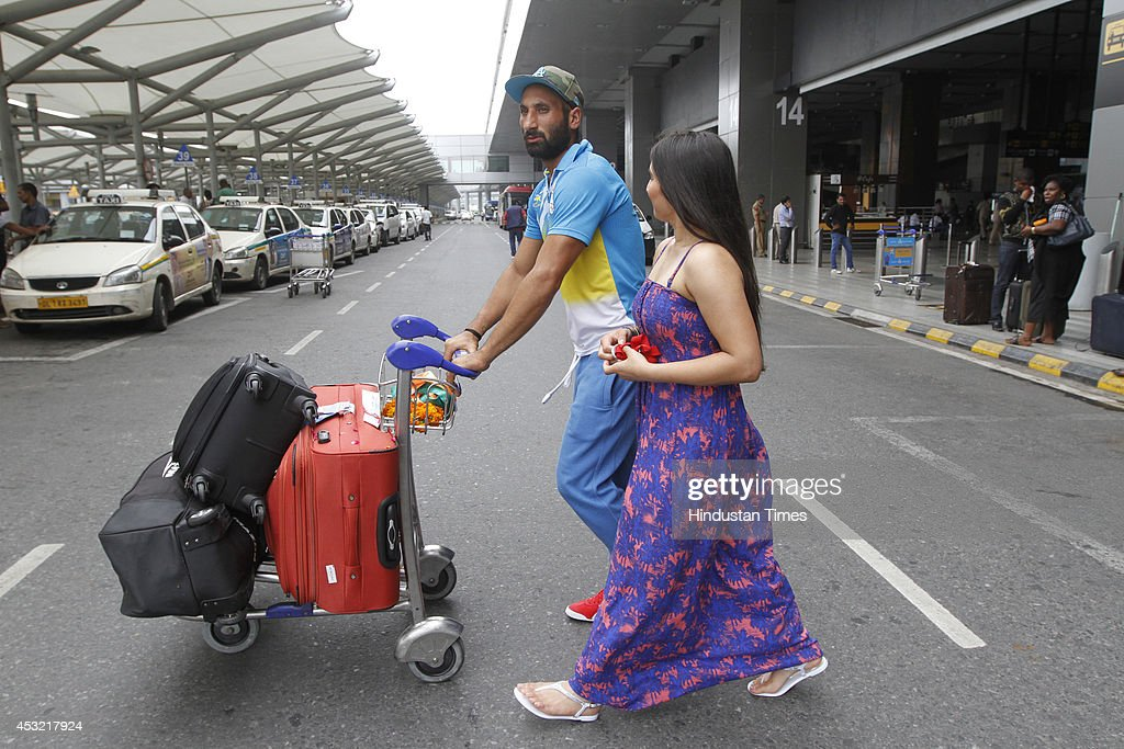 Indian hockey captain Sardara Singh with his fiancee English hockey player Ashpal Bhogal on their arrival at the IGI Airport after participating in CWG 2014 held at Glasgow on August 5, 2014 in New Delhi, India.