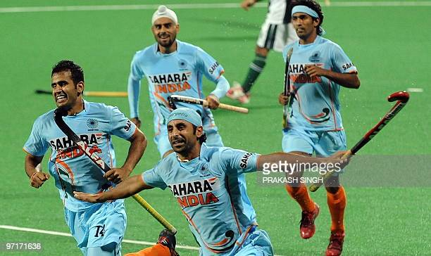 Indian hockey player Prabhjot Singh celebrates a goal against Pakistan with teammates during their hockey World Cup 2010 match at the Major Dhyan...