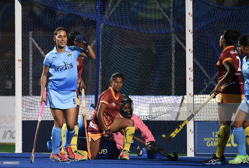 Indian hockey player Preeti Dubey (L) celebrates after scoring a goal against Sri Lanka during the final match between India and Sri Lanka at the 12th South Asian Games 2016 in Guwahati on February 11, 2016. AFP PHOTO/ Biju BORO / AFP / BIJU BORO