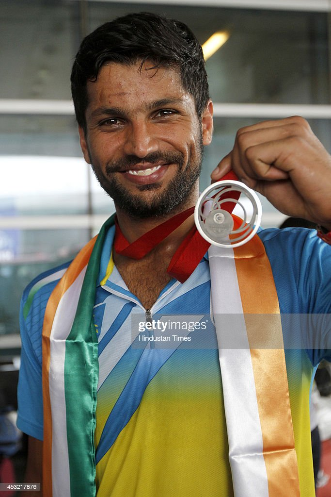 Indian hockey player Rupinder Pal Singh shows his silver medal on arrival at the IGI Airport after participating in CWG 2014 held at Glasgow on August 5, 2014 in New Delhi, India.