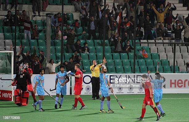 Indian hockey player Sandeep Singh celebrates after scoring a goal during the FIH London Olympics men's hockey qualifying match between India and...